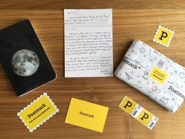 A photo of the package we sent to people. Field Notes, stickers, a hand-written letter, and some first-class stamps.
