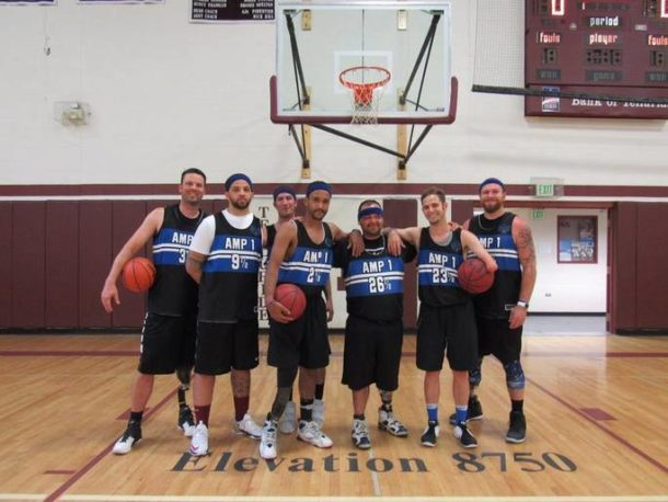 Photo of an amputee stand-up basketball team.