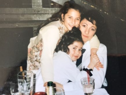 Natalie with her mom and sister